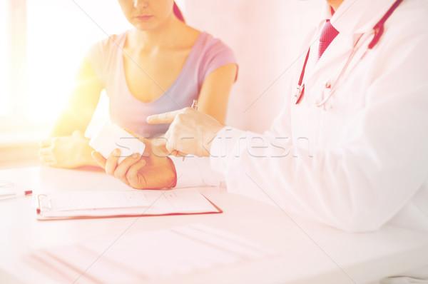 patient and doctor prescribing medication Stock photo © dolgachov
