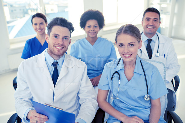 Grupo feliz médicos seminario hospital profesión Foto stock © dolgachov