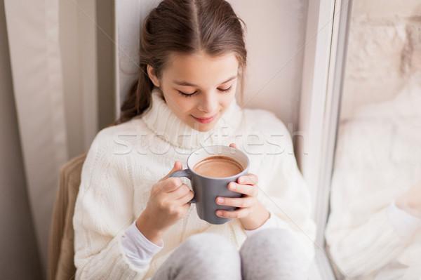 Kız kakao kupa oturma ev pencere Stok fotoğraf © dolgachov