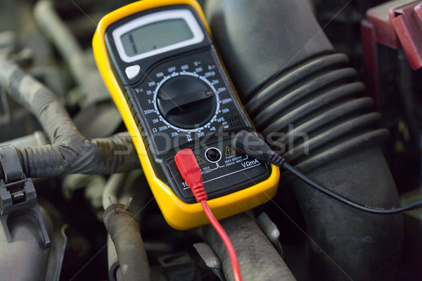 multimeter or voltmeter testing car battery Stock photo © dolgachov