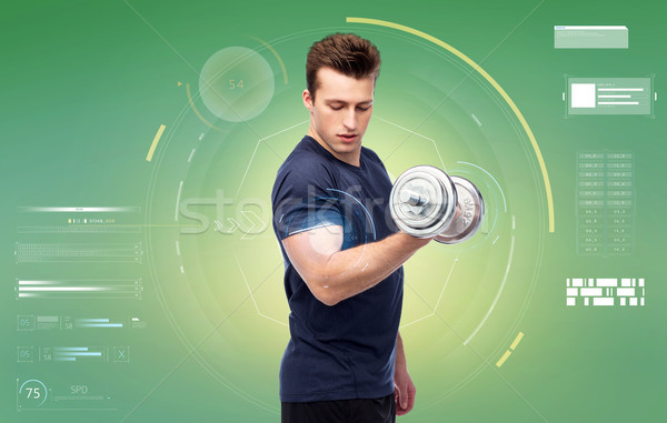 sportive young man with dumbbell Stock photo © dolgachov