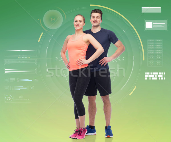 happy sportive man and woman Stock photo © dolgachov