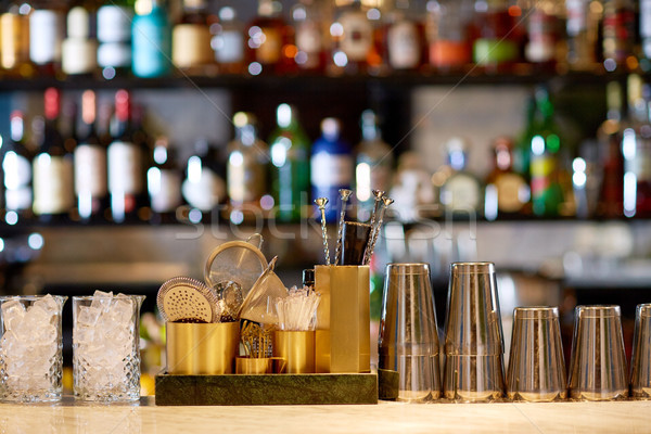 shakers, glasses, stirrers and strainers at bar Stock photo © dolgachov