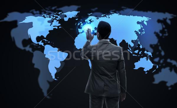 businessman working with virtual world map Stock photo © dolgachov