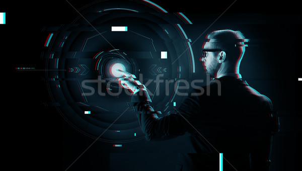 businessman pointing finger to virtual projection Stock photo © dolgachov