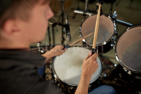 man playing drums at concert or music studio Stock photo © dolgachov