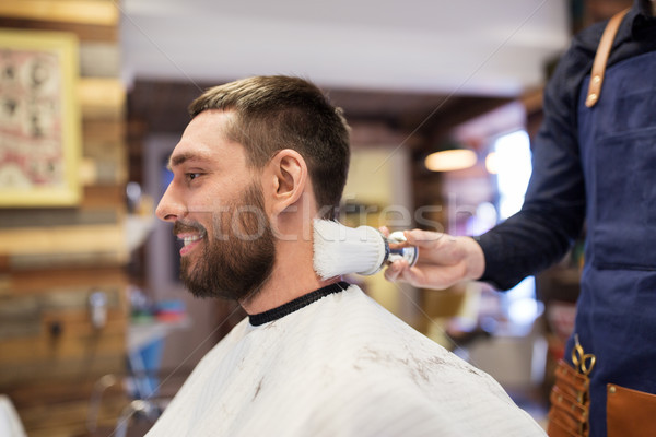 barber with brush cleaning male neck at barbershop Stock photo © dolgachov