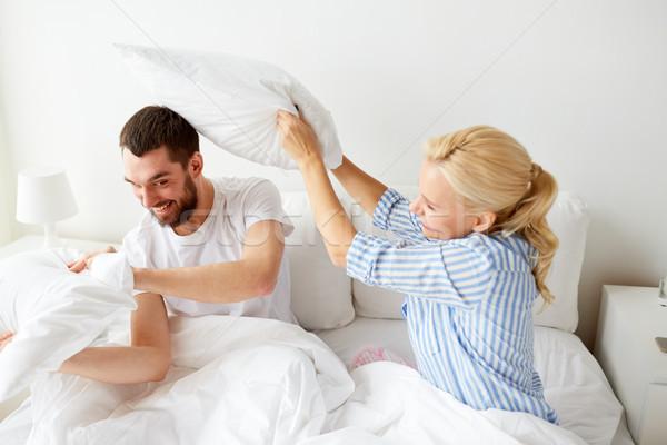 счастливым пару кровать домой люди Сток-фото © dolgachov