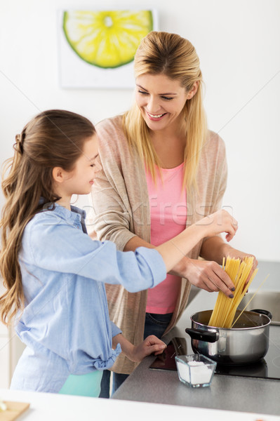 Stock photo: happy family cooking food at home kitchen