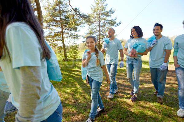 volunteers with garbage bags walking outdoors Stock photo © dolgachov