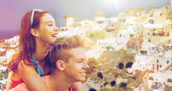 Boldog tini pár szórakozás Santorini utazás Stock fotó © dolgachov