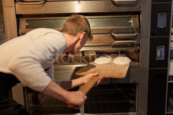 Padeiro pão forno padaria comida cozinhar Foto stock © dolgachov