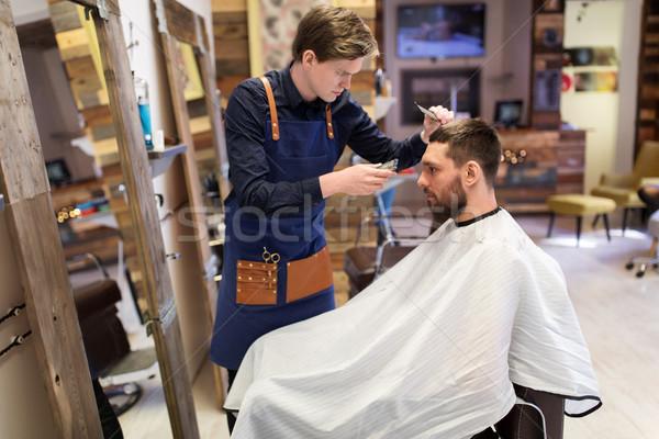 Férfi fodrász körülvágó vág fodrászat hajviselet Stock fotó © dolgachov