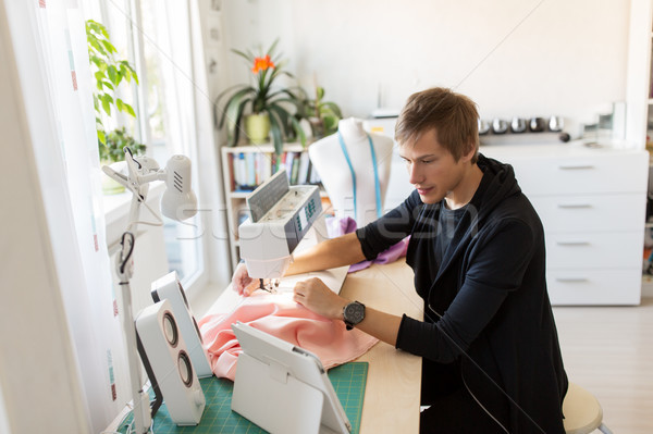 fashion designer with tablet pc sewing at studio Stock photo © dolgachov