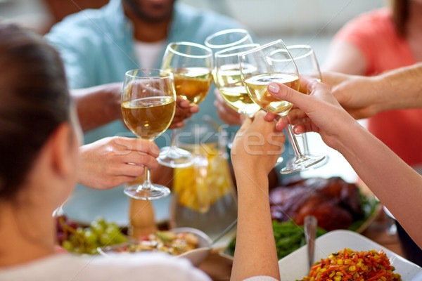 hands clinking wine glasses Stock photo © dolgachov