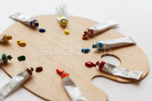 palette and acrylic color tubes or paint Stock photo © dolgachov