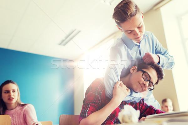 student boy suffering of classmate mockery Stock photo © dolgachov