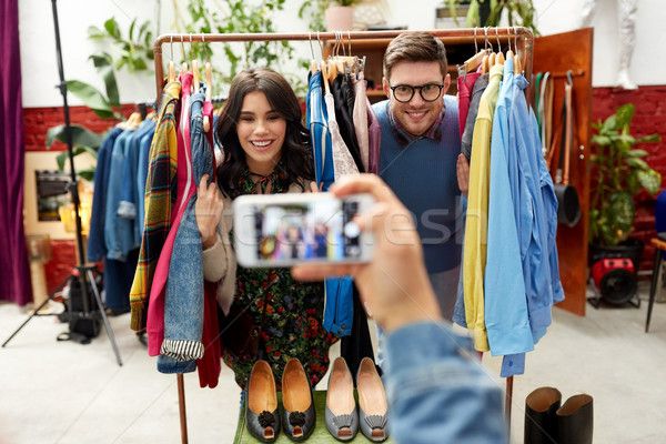 friend photographing couple at clothing store Stock photo © dolgachov
