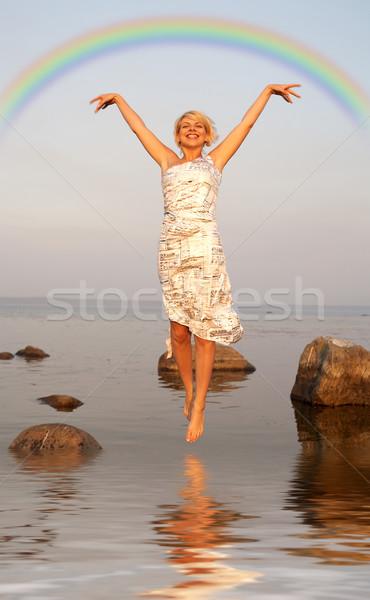 Vlucht regenboog blond springen water kleurrijk Stockfoto © dolgachov