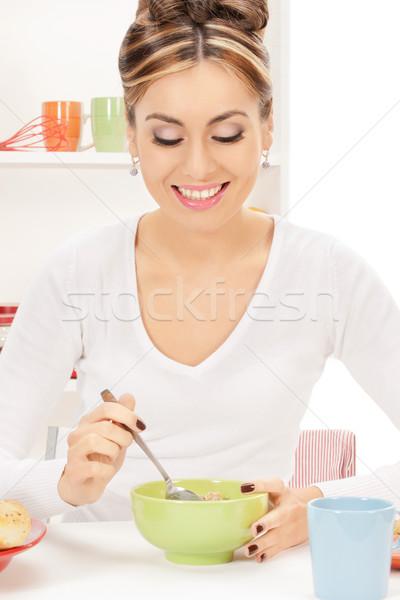 Ev kadını fincan müsli parlak resim kadın Stok fotoğraf © dolgachov