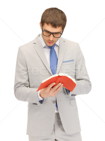 calm and serious man with book Stock photo © dolgachov