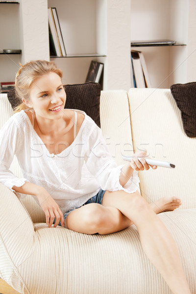 happy teenage girl with TV remote Stock photo © dolgachov