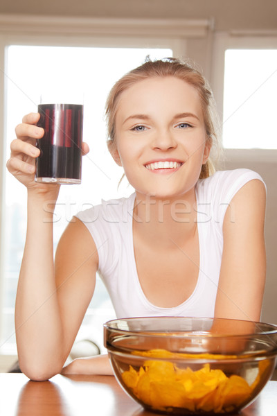 smiling teenage girl with chips and coke Stock photo © dolgachov