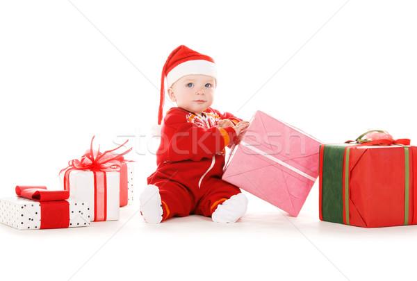 santa helper baby with christmas gifts Stock photo © dolgachov