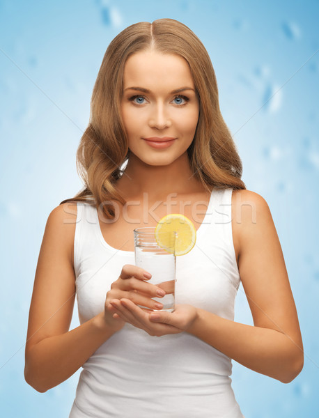 woman with lemon slice on glass of water Stock photo © dolgachov