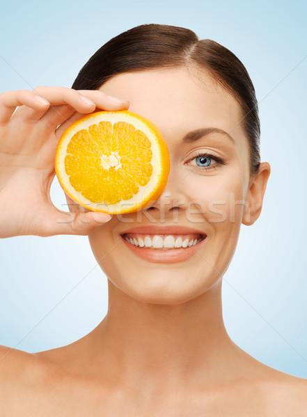 Vrouw orange slice heldere foto mooie vrouw gelukkig Stockfoto © dolgachov
