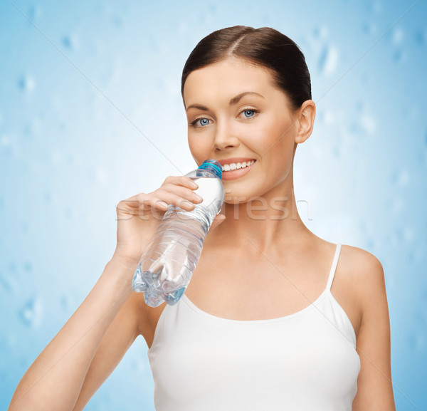 woman with bottle of water Stock photo © dolgachov