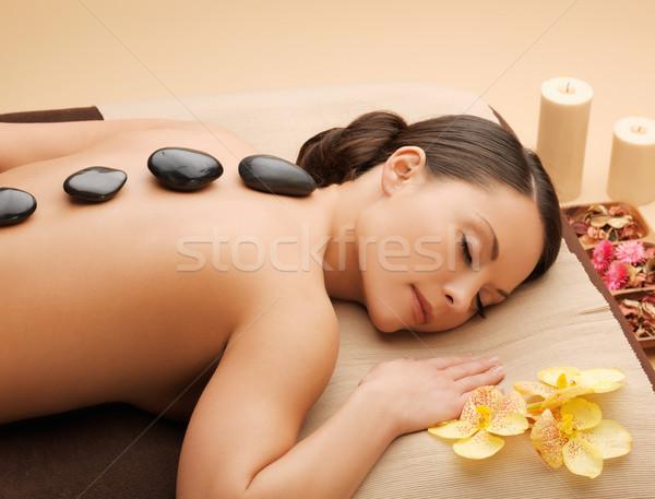 beautiful woman with hot stones Stock photo © dolgachov