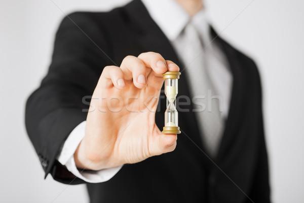Uomo mano clessidra clock Foto d'archivio © dolgachov