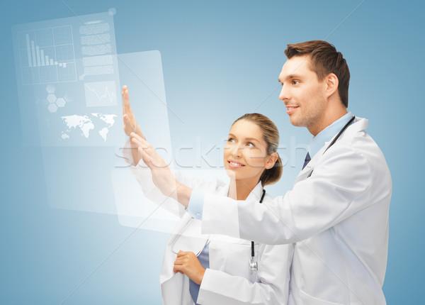 Сток-фото: два · врачи · рабочих · виртуальный · экране · фотография