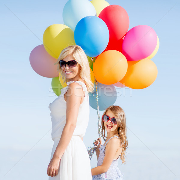 Stock photo: mother and child with colorful balloons