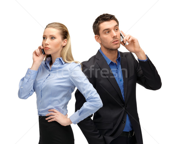 woman and man with cell phones calling Stock photo © dolgachov