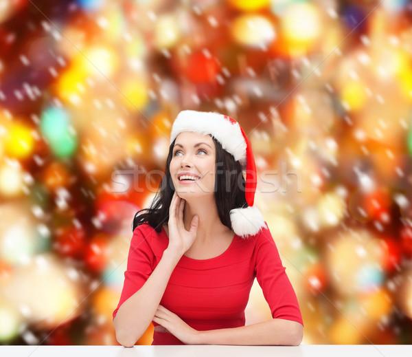 Zdziwiony kobieta Święty mikołaj pomocnik hat Zdjęcia stock © dolgachov