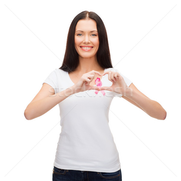 smiling woman with pink cancer awareness ribbon Stock photo © dolgachov