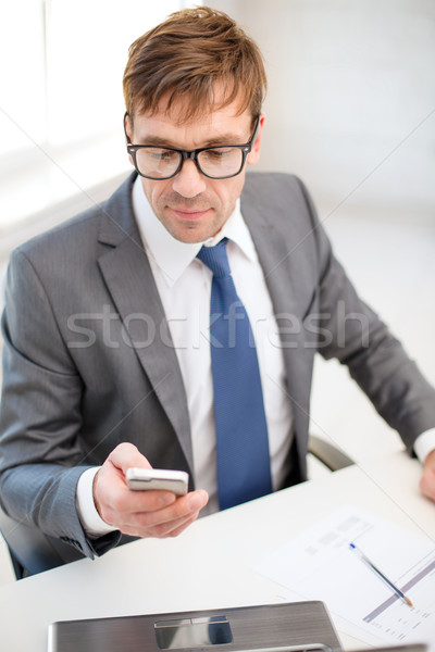 businessman working with laptop and smartphone Stock photo © dolgachov