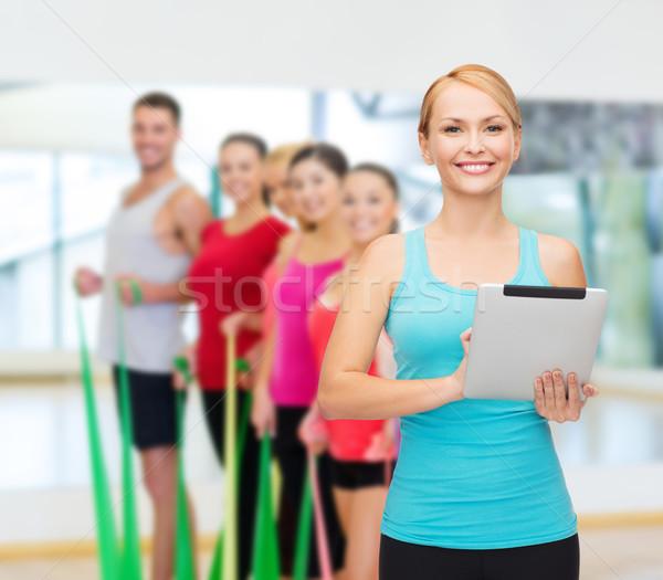 sporty woman with tablet pc Stock photo © dolgachov