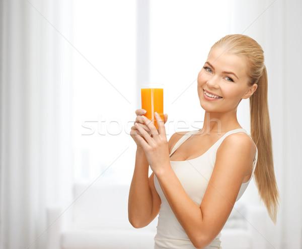 Glimlachende vrouw glas sinaasappelsap gezondheid dieet Stockfoto © dolgachov