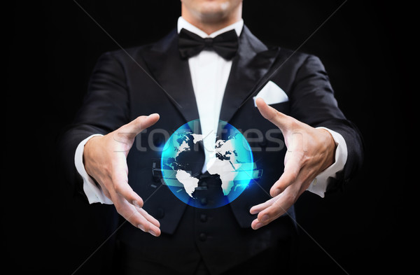 magician in top hat showing globe hologram Stock photo © dolgachov