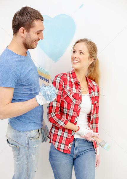 Stockfoto: Glimlachend · paar · schilderij · klein · hart · muur