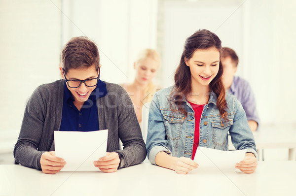 two teenagers looking at test or exam results Stock photo © dolgachov