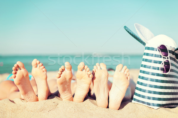 Três mulheres praia férias de verão banhos de sol pedicure Foto stock © dolgachov