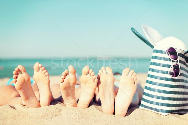 three women lying on the beach Stock photo © dolgachov