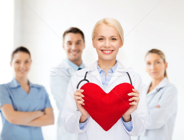 smiling female doctor with heart and stethoscope Stock photo © dolgachov