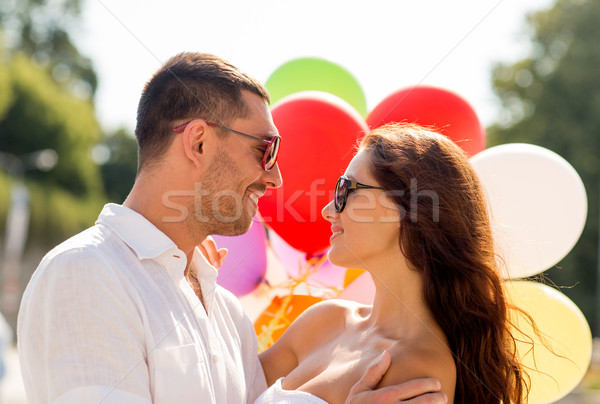 smiling couple in city Stock photo © dolgachov