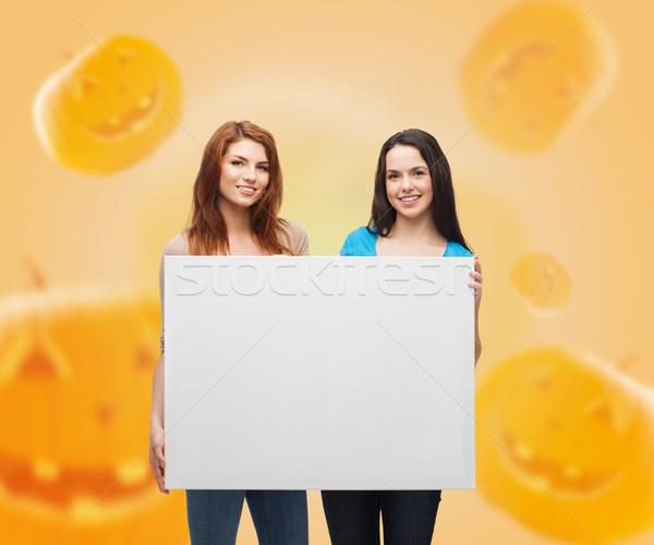 Gülen beyaz tahta reklam eğitim tatil Stok fotoğraf © dolgachov