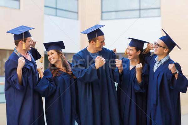 группа улыбаясь студентов образование окончания люди Сток-фото © dolgachov